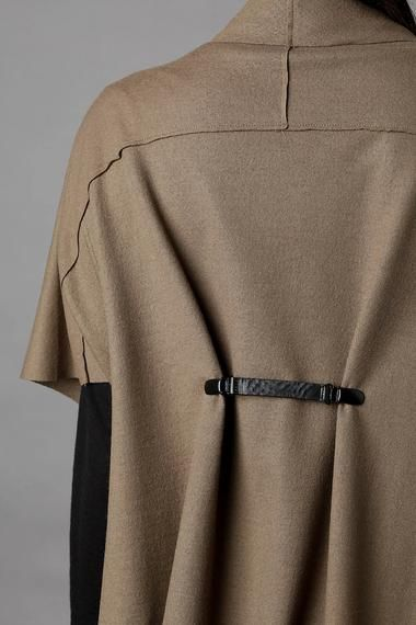 Joan do you remember clips you wear in the back of a top to cinch the waist?  I still have some.