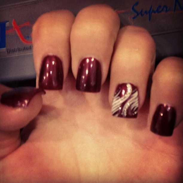 mah nails with a burgundy, silver, and white wings? design...love love love