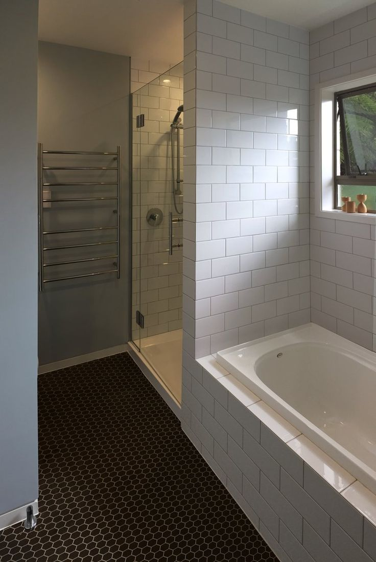 Black and white bathroom with hexagon flooring and white subway tiles