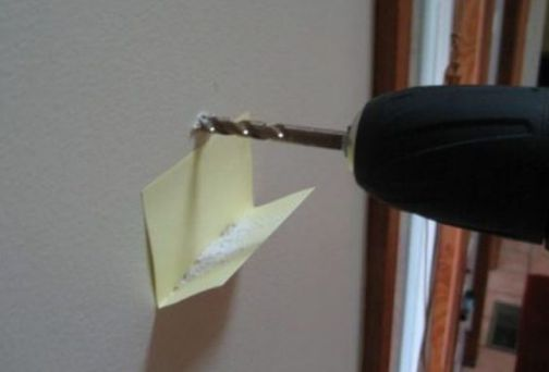 If you're drilling into drywall and making a mess, stick a Post-It underneath to collect the dust. (Instead of having to vacuum later.) | 33 Genius Life Hacks That Are Actually Useful