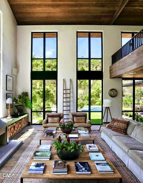 Love the tall narrow windows (how ridiculous do those books look on the coffee tables - trying way too hard)!
