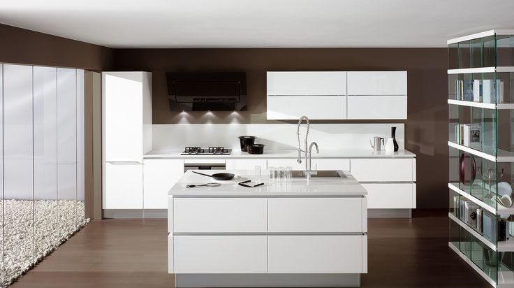 """A kitchen that makes minimalism its trump card, offering a new solution for functionality requirements. Its outstanding features include its pure flat door, the up-to-date feel of the wood, the brilliant glow of modernity in the gloss lacquers, the futuristic elegance of the matte lacquers and the Shell System structure, a revolutionary """"shell-type"""" construction system."""