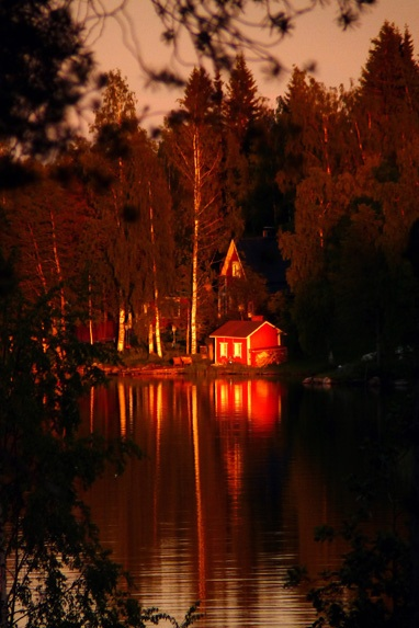 Red hut in the last light of the evening of summer solstice, Kuopio, Finland