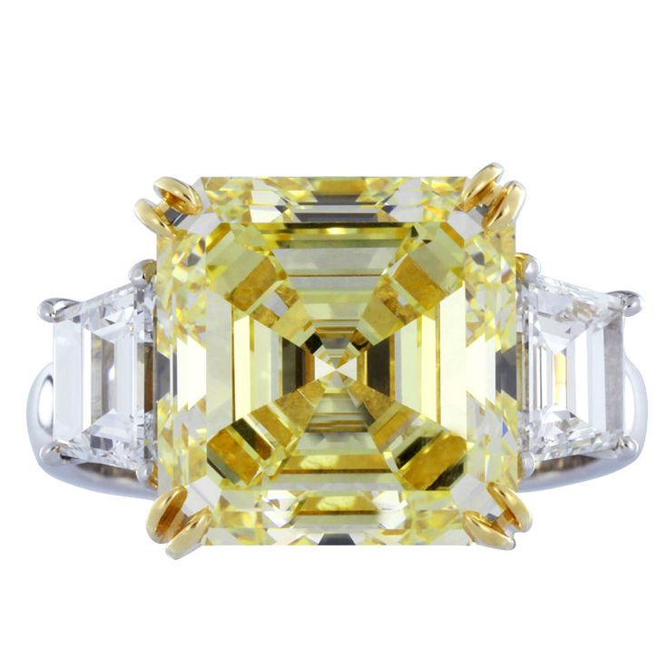Rare and Magnificent Asscher cut Yellow Diamond Ring Contemporary  Platinum / 18 K YG natural square emerald cut canary diamond (7.03ct fancy yellow/VS-1 w/GIA cert #10237242) flanked by 2 step cut trapezoid diamonds (1.22 Cts TW F/VS-1) custom made 3 stone ring.