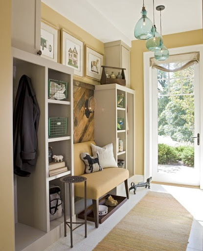 Option for mud room with tall hanging space & shelves with bench in middle.