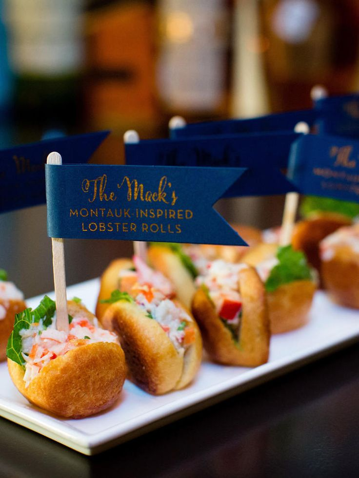 Adorn the appetizers with a little nautical flag telling guests where the seafood was caught as a way to support the local cuisine from your chosen wedding location.