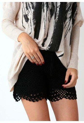 black crochet shorts.