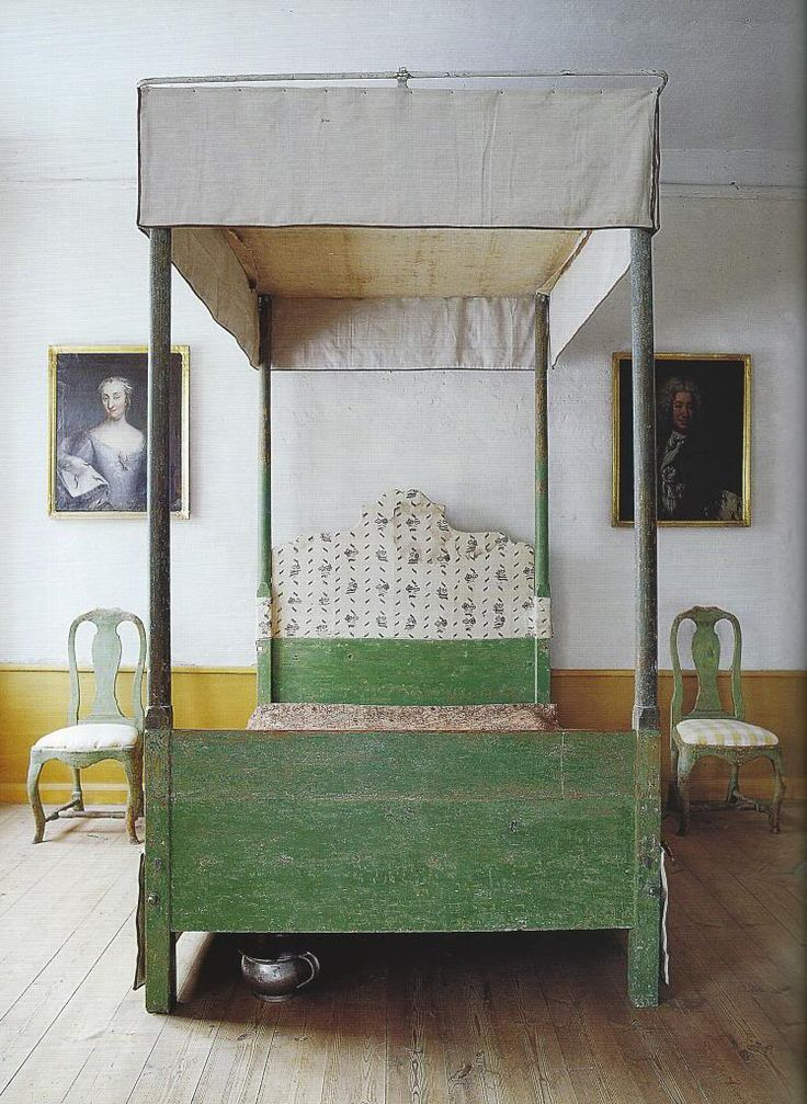vintage style eclectic canopy bed. I love the green in this bedroom and the vintage oil portrait
