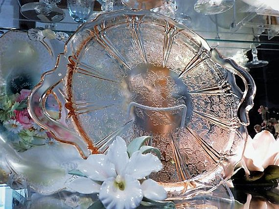 ITEM #RA-78  1930s Cherry Blossom pink depression glass platter produced by the Jeannette Glass Co.  Platter is listed in the Collectors Encyclopedia of Depression Glass by Gene and Cathy Florence as 13 but actually measures 12 1/2 handle to handle by 10 1/4.  Condition: Very good antique-vintage condition with typical wear due to age and handling. No chips, cracks etc. **** I have purchased an estate full of glassware, and have more of this pattern. If you are looking for something...