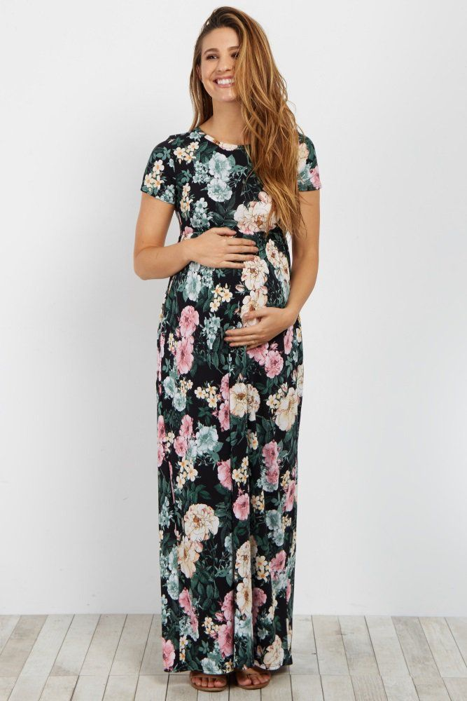7260dff67f7dc Floral printed plus maternity maxi dress. Short sleeves. Cinched under  bust. Rounded neckline.
