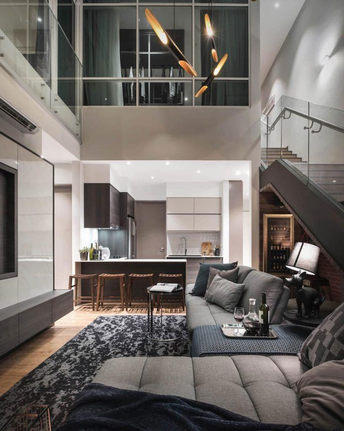High ceiling duplex apartment in the heart of Penang by Vault Design Lab