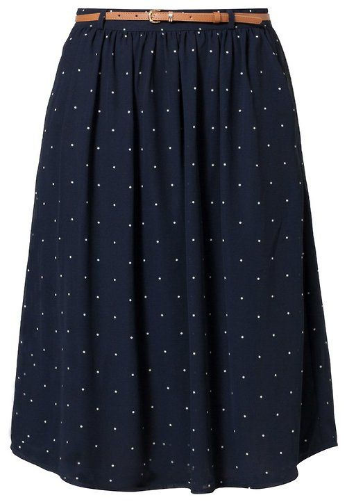 Navy pleated skirt with small polka dots and a brown belt! Love!