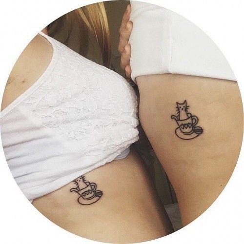 tatuaggio tra sorelle con gattini