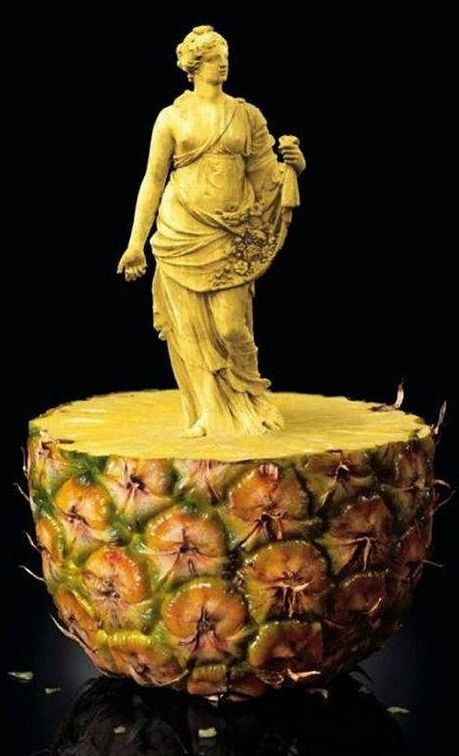 Statue carved from pineapple.  Amazing.