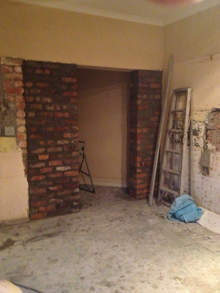 Building up walls and blocking the old entrance to make a pantry
