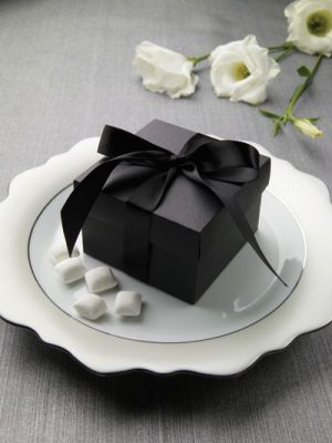 These sleek and sophisticated self-assembly favor boxes are made of matte black papers and include satin ribbon for wrapping. They're great for reception favors or wedding party gifts! Just fill with your favorite favor candies, gifts or related items. Finished size: 2 7/8-inches x 2 7/8-inches x 2-inches. Not a printable item. 50 count.