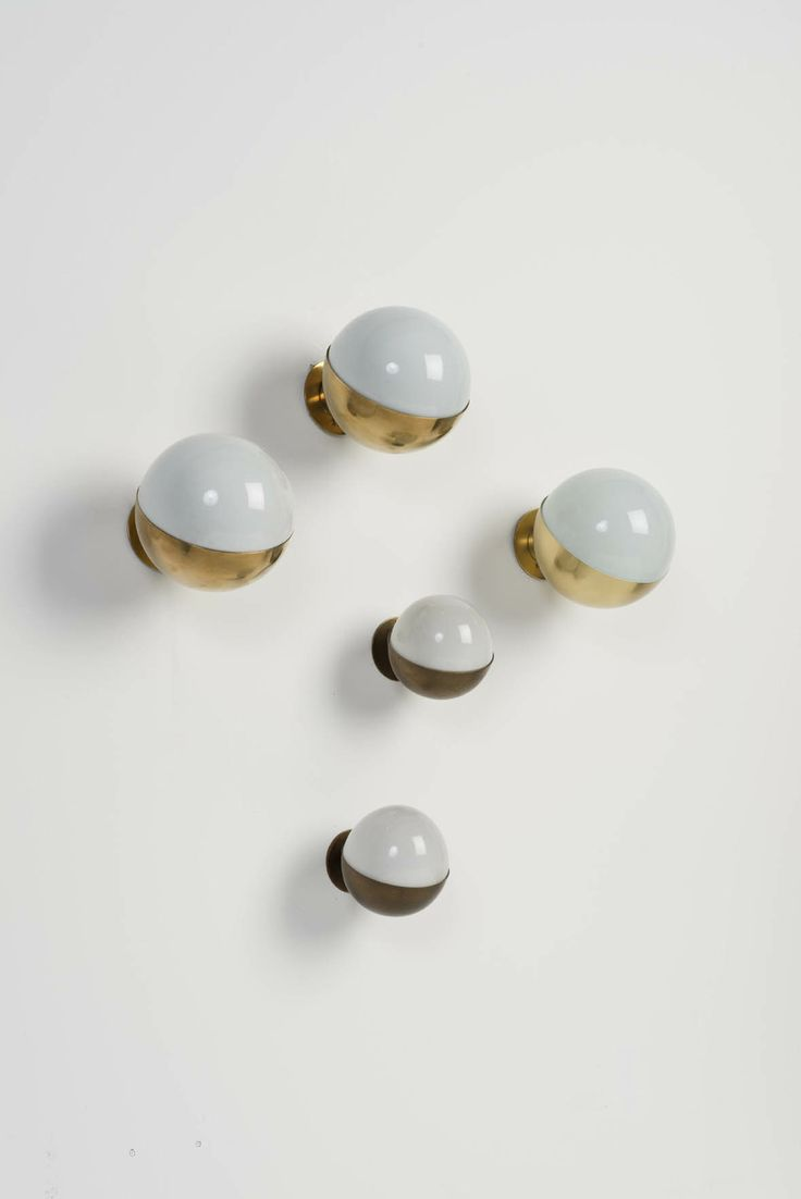 Vilhelm Lauritzen; Brass and Opaline Glass Wall Lights, c1960.