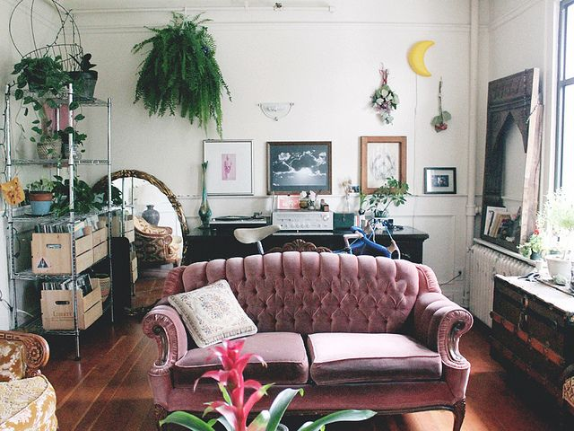 Eclectic bohemian chic living space. Love the vintage blush sofa.