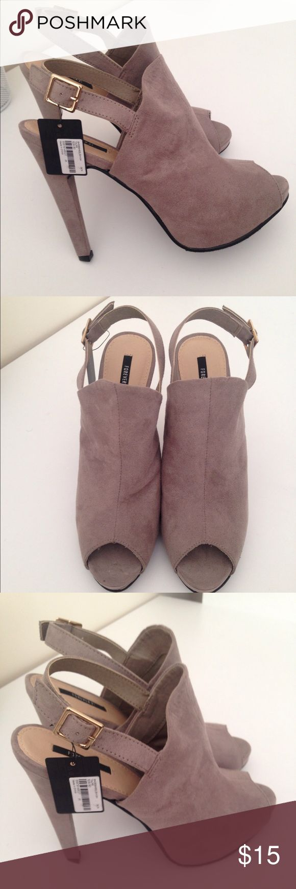 Never worn Forever 21 booties Perfect booties for work or a night out. A pretty taupe color that matches with anything, and a killer heel to enhance every outfit. Forever 21 Shoes Heels