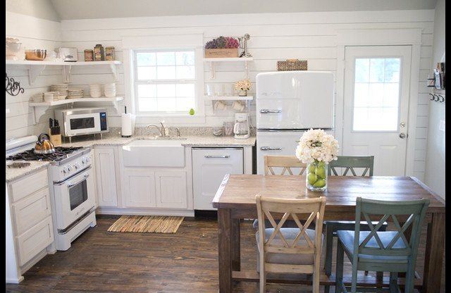 Farmhouse kitchen with open shelving.   Retro Big Chill appliances.   Cozy cottage vacation rental in Mena, Arkansas