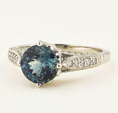 Teal sapphire centre stone and the detailing on the shoulders, so pretty! #perfectring
