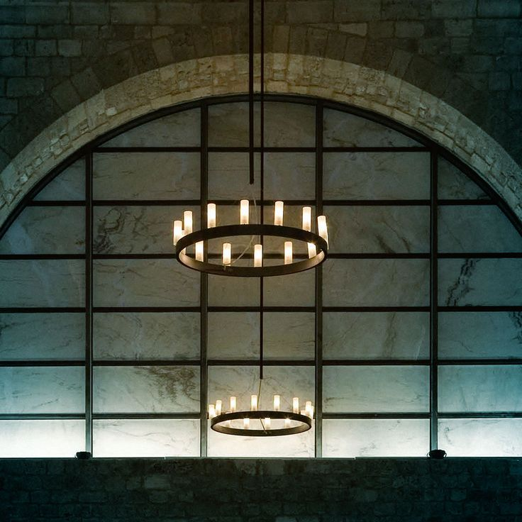 Chandelier (lighting): Suspension lamp. Structure in grey aluminium or black plated brass. Stainless steel Hanging cables. Sandblasted borosilicate glass diffusers. (designer: David Chipperfield | year: 2004) - More @ www.fontanaarte.com #fontanaarte #light #lamp