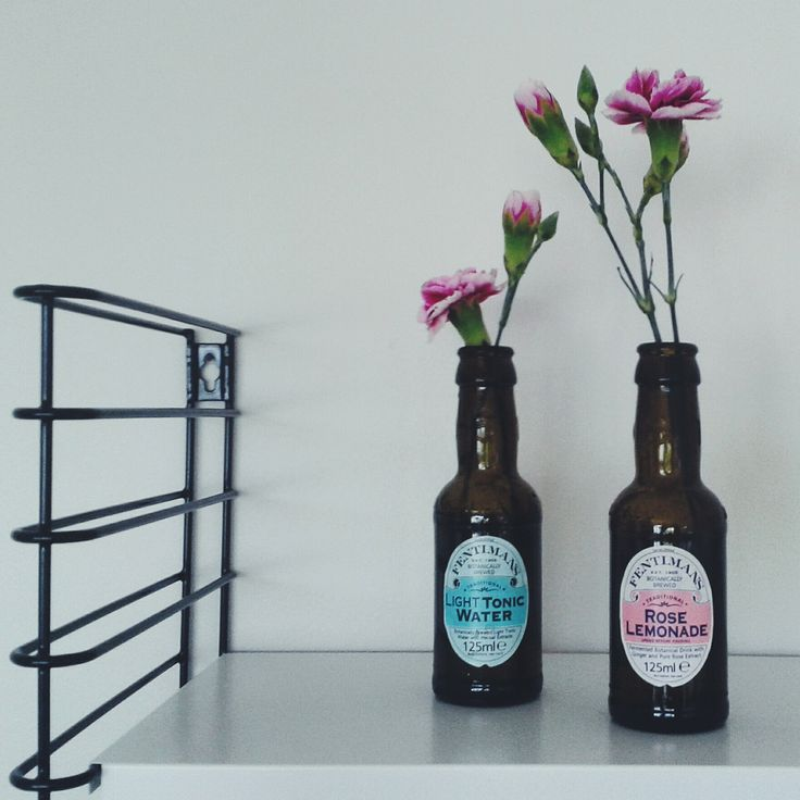 Re-used tonic bottles on Tomado shelfs.