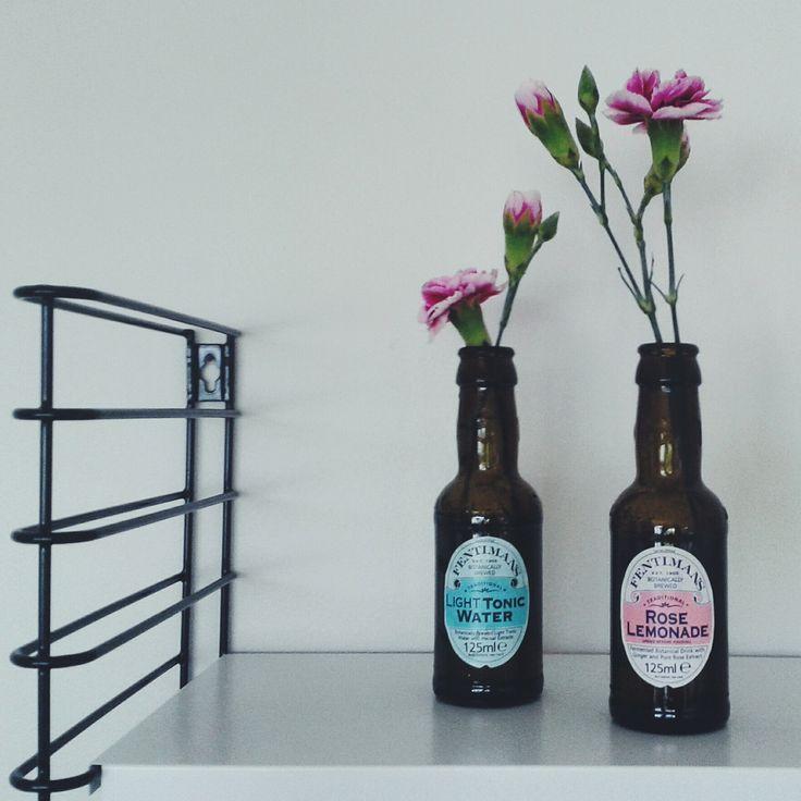 Re-used tonic bottles on Tomado shelfs.