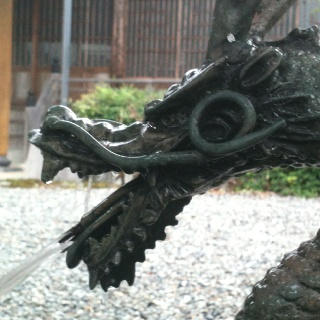 A dragon spout at the cleansing pool at Hozenji in Kashimo