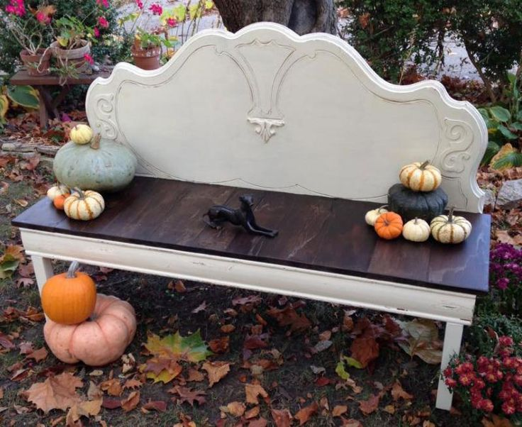 """This bench was built using a vintage, mahogany headboard, barn wood, and trim that was removed from both an old house and a newer house... The barn wood seat was stained with an oil based stain that allowed the wear marks and old stains to show through, then was sealed with General Finishes High Performance Top Coat in Flat. The rest of the bench was painted with GF Milk Paint, Antique White, then distressed, to highlight the details, and then clear waxed."" - Garage 9"