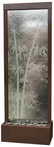 """Gardenfall Bamboo Glass 72"""" High Indoor/Outdoor Fountain by Universal Lighting and Decor. $995.00. Indoor/outdoor.. Includes one halogen accent bulb.. 15"""" deep.. Submersible pump included.. 72"""" high.. Water flows down the glass panel etched with soft bamboo silhouettes and into the basin of polished river rocks in this indoor/outdoor fountain. Featuring a dark copper frame and reservoir, this Asian-inspired water feature creates a mood of serenity as it humidifies and cle..."""