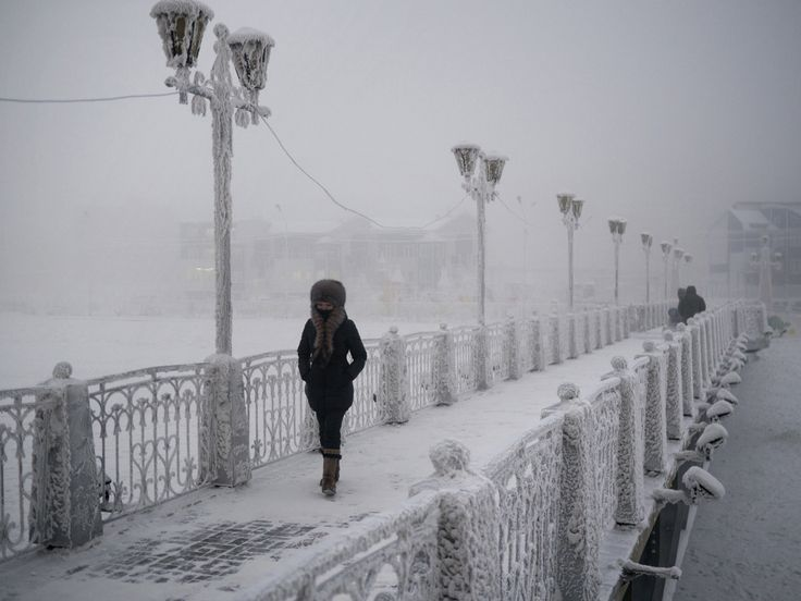 What It's Like Living in the Coldest Town on Earth | In the city of Yakutsk, a woman walks over a frost-coated bridge.    Amos Chapple  | WIRED.com