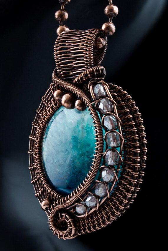 The aqua blue in this dyed agate bead reminds me of the ocean. I used the dyed agate bead as my focal point and accented it with some sparkly glass beads that remind me of white caps in the ocean when the waters are churning. I used bare copper wire to create this pendant in my own design. The finished piece measures approximately 5 cm by 3-1/2 cm wide. The piece has been oxidized and polished to bring out a warm and rich copper color. This pendant comes with a ball chain necklace that i...