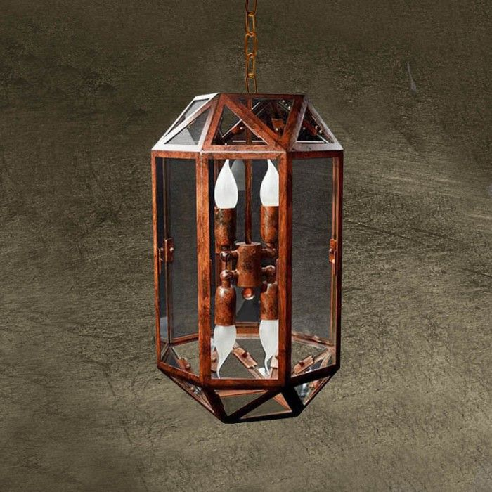 Lantern with diffused light used hung by a chain. It is created with an eight faced iron frame and with a diamond shaped base and top. Finish: Oxidized iron with transparent glass. - See more at: http://www.rivieraluxe.it/en/_37#sthash.nDfKBKHB.dpuf