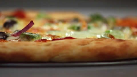 This no-rise pizza dough recipe involves mixing a few basic ingredients and patting the dough into the pan. The crust is ready in 35 minutes.