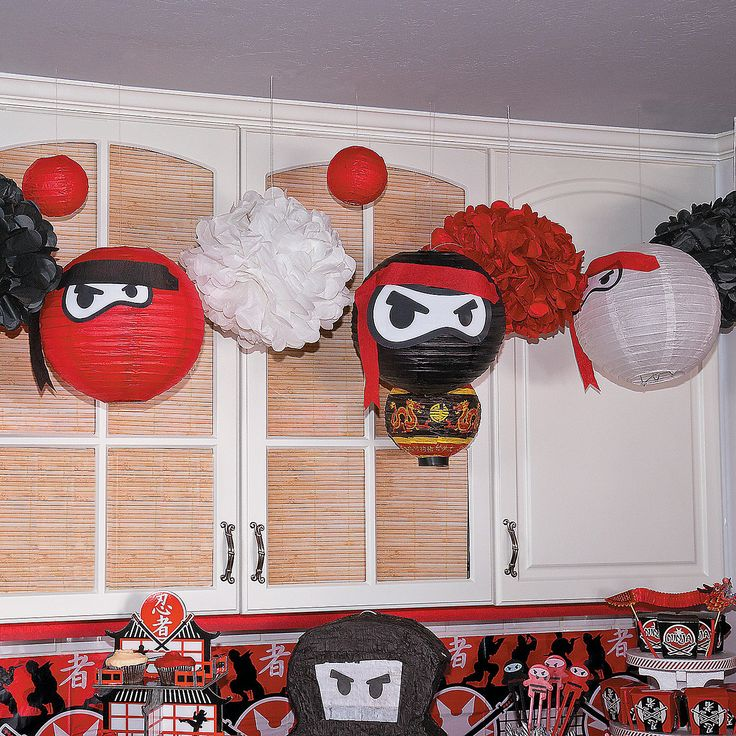 Ninja Paper Lanterns Idea | These stealthy ninjas will spice up your ninja party in no time! Hang these adorable DIY party decorations from the ceiling for ninja-approved party look. #ninja #party #decorations