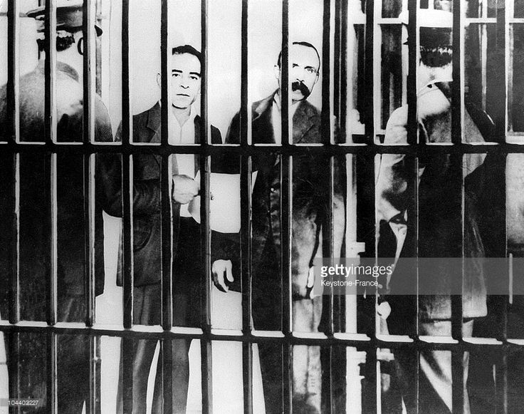The two Italian anarchists, Nicolas SACCO and Bartholomeo VANZETTI, behind prison bars before their execution in the electric chair August 23, 1927 in the United States. They were accused of murdering a bank guard and clerk and were both condemned to death.