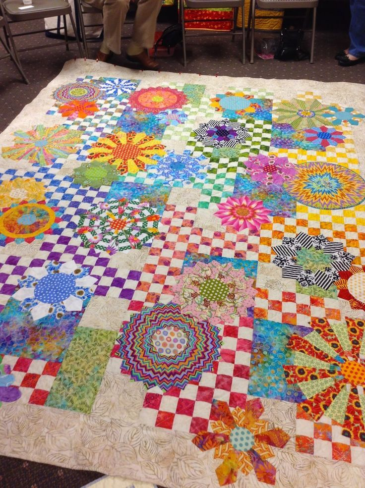 Love this quilt. Bright colors and unusual placement of 16 patch blocks make this quilt sing. xxx