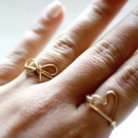 Doll up your hands by making this DIY Wire Bow Ring! This simple and sweet wire jewelry project brings a touch of feminine flair to your finger.