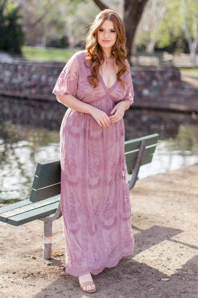 6024187340d2f6 A lace mesh overlay plus size maxi dress featuring beautiful scalloped trim,  semi-sheer short bell sleeves, a v-neckline, and a hidden zipper back  closure.