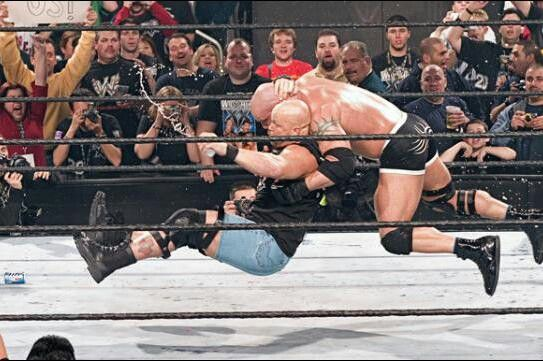 Stone Cold Steve Austin with a Stone Cold Stunner to Goldberg at Wrestlemania 20