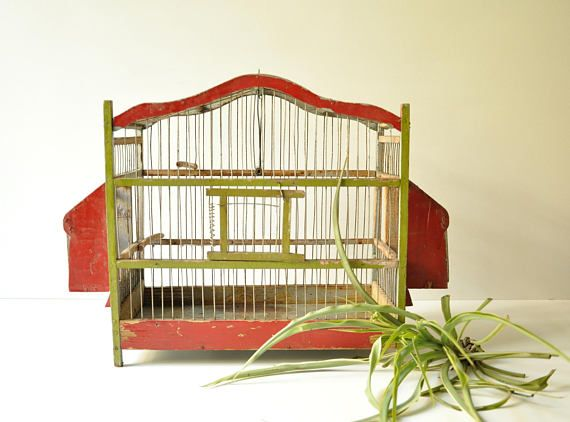 This amazing old bird cage is so full of character! It is mostly made of wood and wire. It would definitely add a lot of character and style to any space used as a hanging plant holder!  It would also make a wonderful addition for your bridal shower, baby shower or special event. In used vintage condition with a rust on the metal parts.  Dimensions: - Height 34 cm - Depth 17.5 cm - Width 46.5 cm…