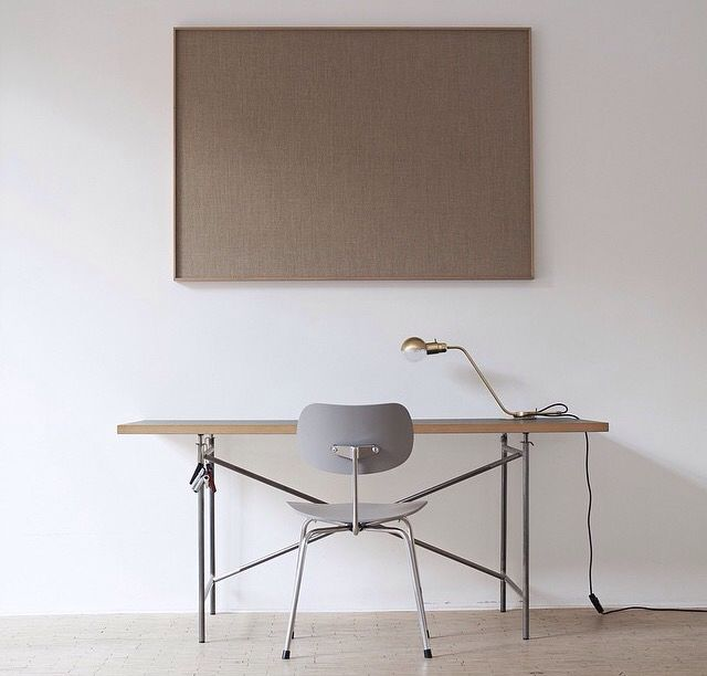 Minimal interior. Egon eiermann chair and brass lamp.