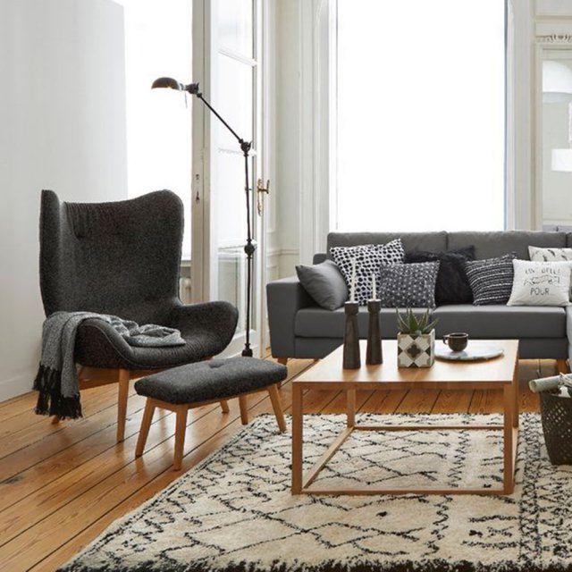 Un fauteuil haut à larges oreilles, La Redoute Intérieurs. Large, gris et chaud, ce fauteuil et son repose pied seront les rois de notre salon pendant tout l'hiver !