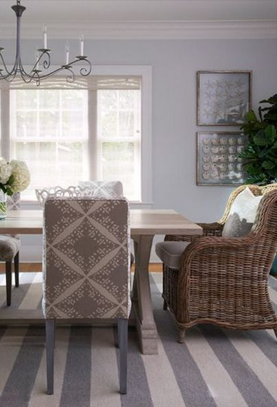 Dining Room With A Striped Grey And White Rug Upholstered Chairs Around Farmhouse Style Table Wicker Armchair At The Head Of Side Chair