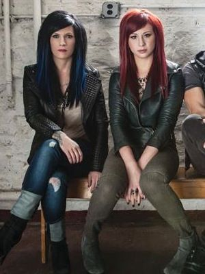 Korey Cooper + Jen Ledger-Skillet can count not one, but two talented woman amongst their ranks. Korey Cooper plays rhythm guitar, keyboards, and provides backing vocals while Jen Ledger provides the backbone of the band behind the kit as well as additional backing vocals.