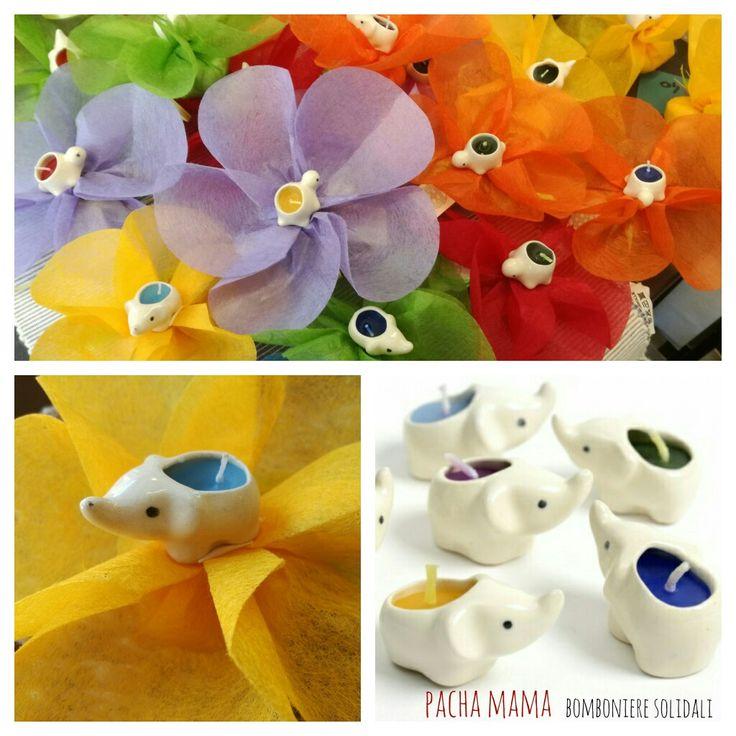 Teneri elefantini e tartarughe in ceramica racchiudono colorate candeline nei colori dell'arcobaleno, fatte con amore dalle brave volontarie di Pacha Mama Rimini