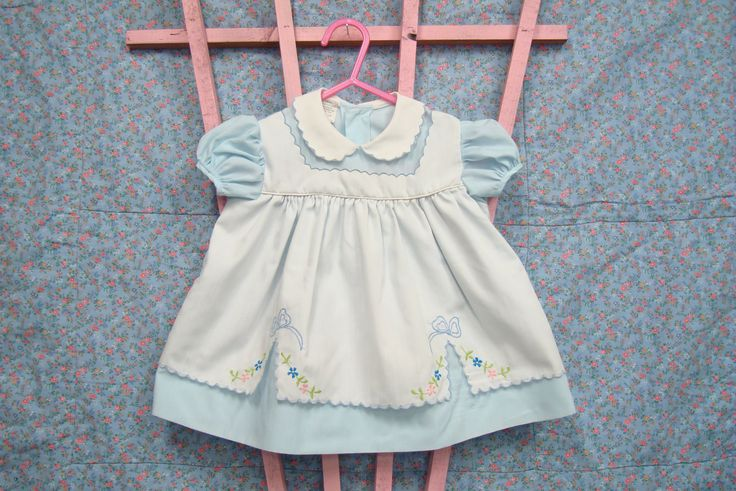 Vintage baby dress with embroidery and scallops.