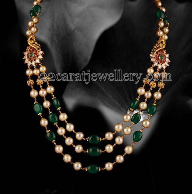 South sea pearls and emerald beads triple layer long chain with antique finish peacocks adorned on the sides. Pear shaped emeralds and gol...