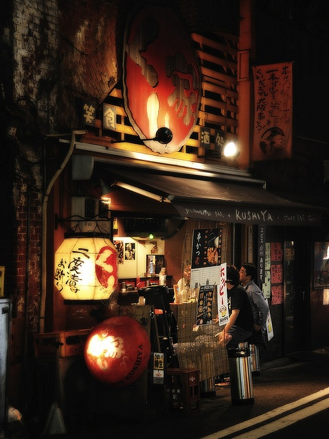 Izakaya ia a Japanese-style bars denoted by their red lanterns known as akachochin and this shot is located under the train track at Yurakucho station, Tokyo, Japan